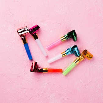 Top view arrangement with whistles and pink background