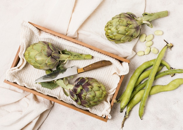 Top view of artichokes and beans