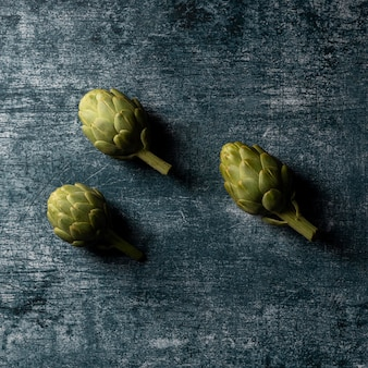 Top view artichokes on table