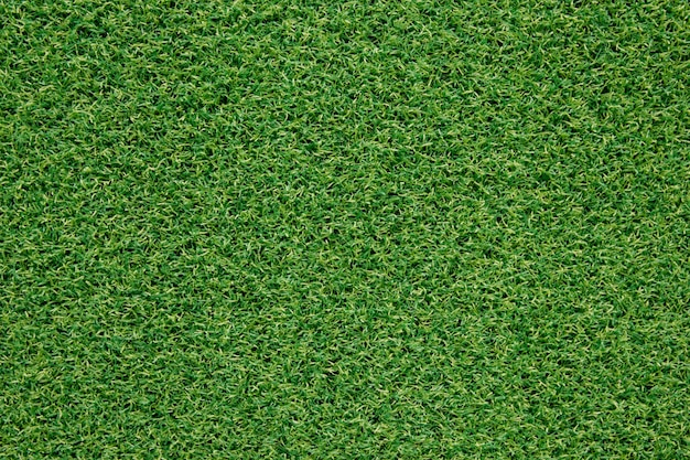 Top view artificial green grass texture for background
