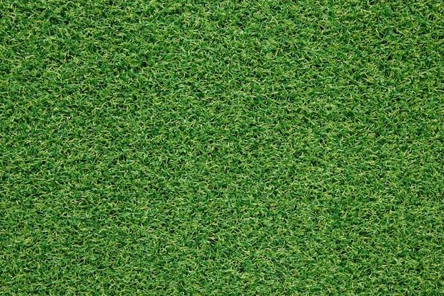 Вид сверху искусственная зеленая текстура травы для фона