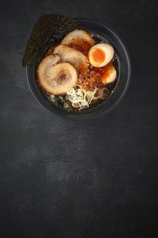 Top view of asian ramen noodle soup with chashu