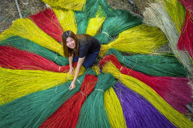 Top view of asian traveler female making the traditional vietnam mats in the old traditional village at dinh yen, dong thap, vietnam, tradition artist concept