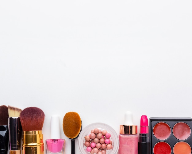 Top view assortment of beauty accessories with copy space