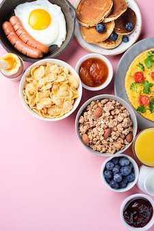 Top view of assortment of breakfast food with blueberries and jam
