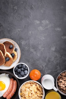 Top view of assortment of breakfast food with copy space
