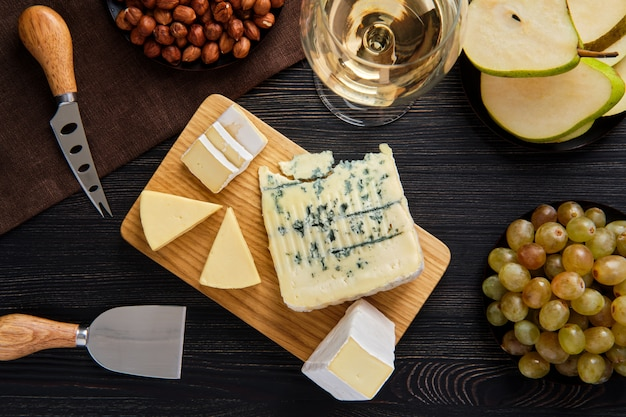 Top view of assortment of cheese and snack for wine