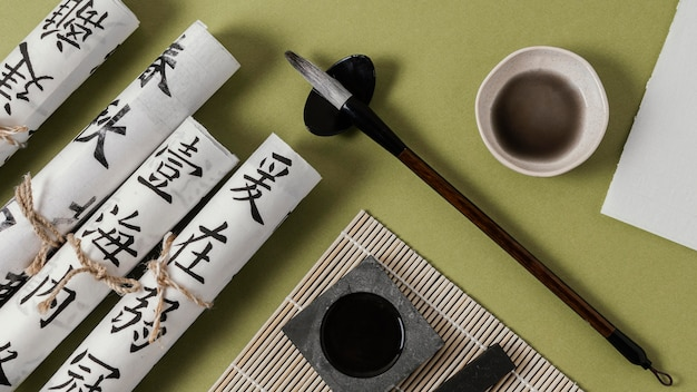 Top view assortment of chinese elements with ink