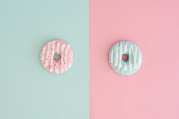 Top view of assortment of colorful doughnuts with glazing