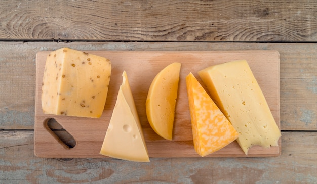 Top view assortment of delicious cheese on the table