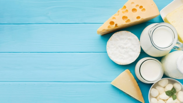 Top view assortment of delicious cheese with copy space
