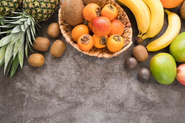 Top view assortment of delicious fruits with copy space