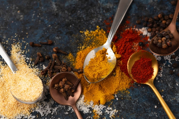 Top view assortment of delicious raw spices