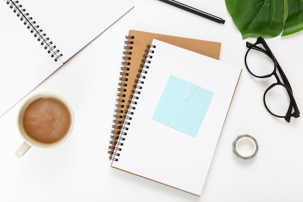 Top view assortment of desk elements with notebooks