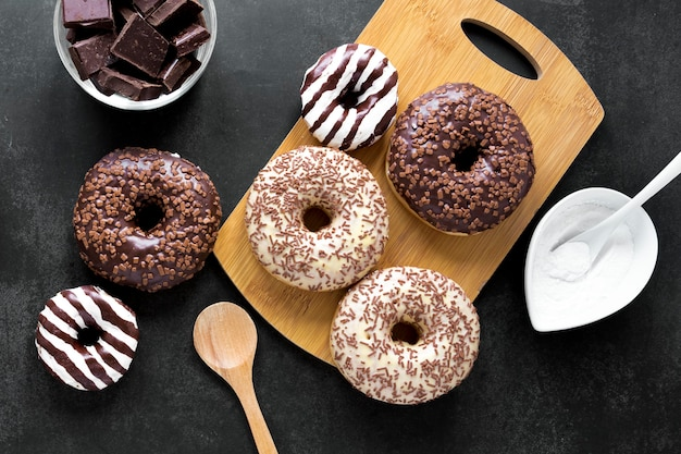 Top view of assortment of doughnuts with sprinkles