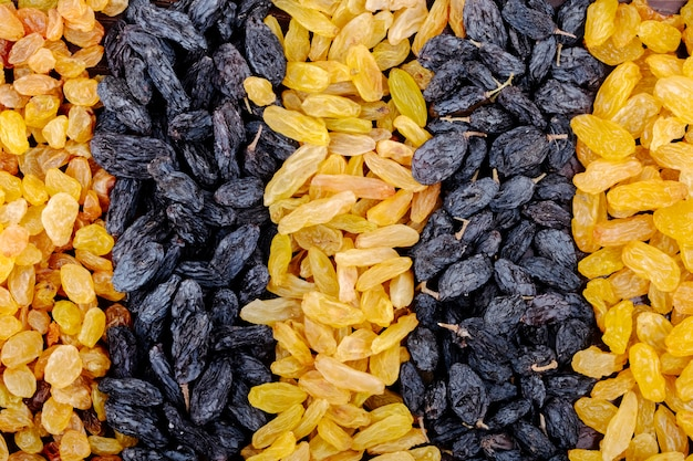 Top view of assortment of dried fruits black and yellow raisins