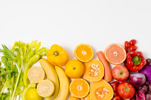Top view assortment of fresh fruits with copy space