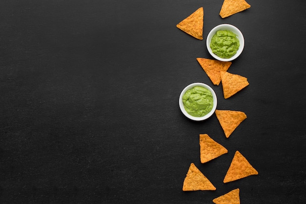 Top view assortment of nachos with guacamole