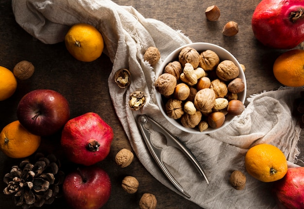 Top view of assortment of nuts with autumn fruit