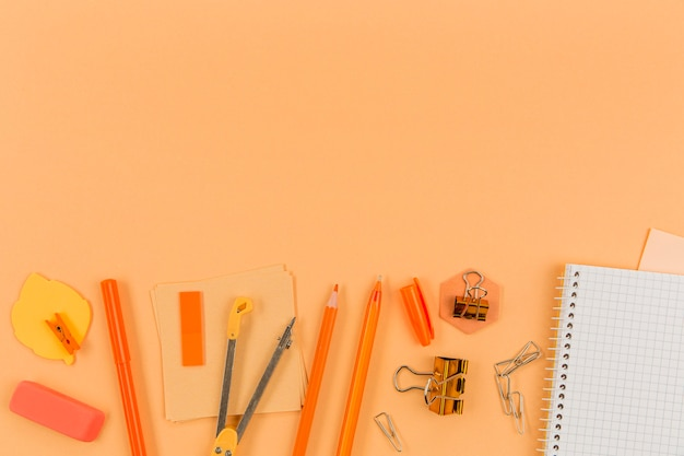 Top view assortment of office supplies with copy space