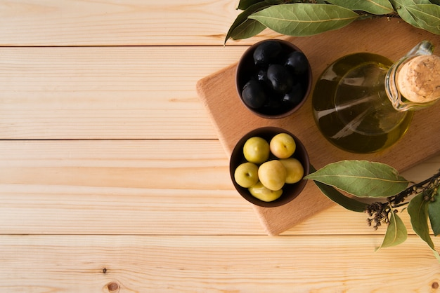 Top view assortment of olives and oil