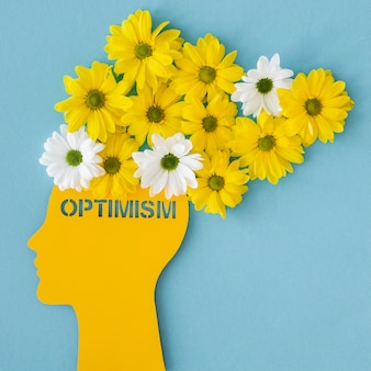 Top view assortment of optimism concept with flowers