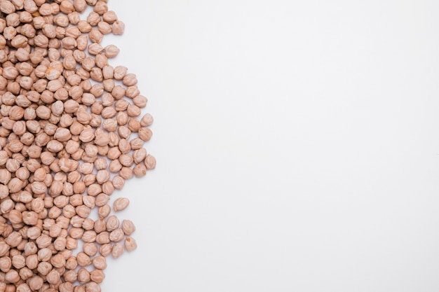 Top view assortment of organic chickpeas with copy space