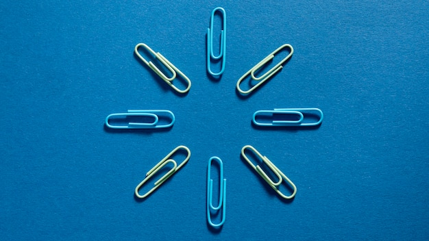 Top view assortment of paper clips on the table