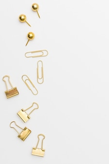Top view assortment of paperclips with copy space