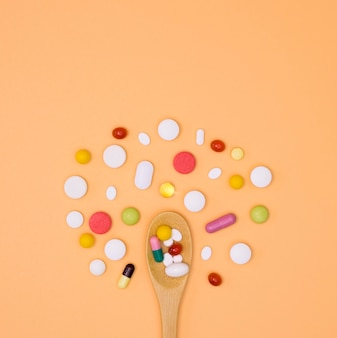 Top view of assortment of pills with spoon
