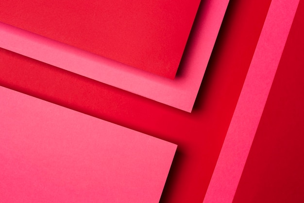 Top view assortment of red paper sheets background
