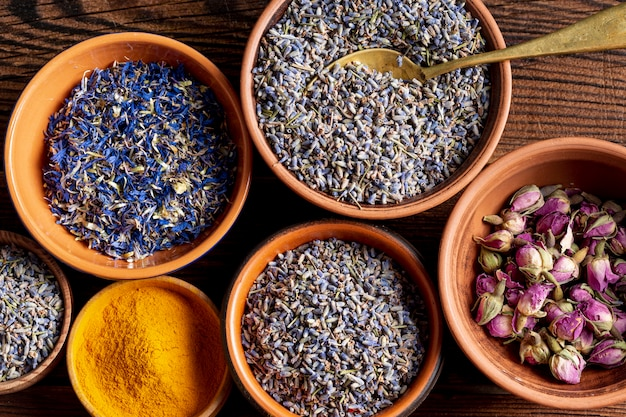 Top view of assortment of spices with lavender and turmeric