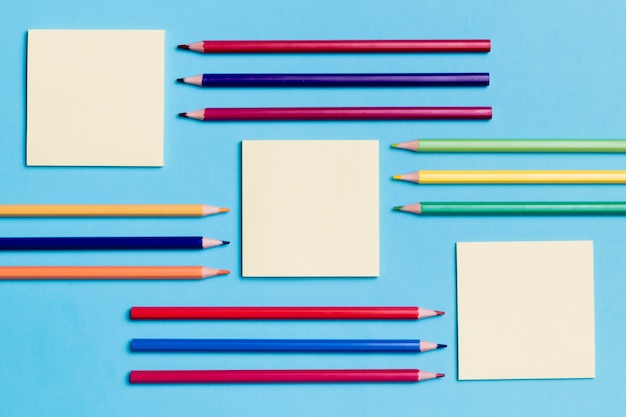 Top view assortment of sticky notes and pencils