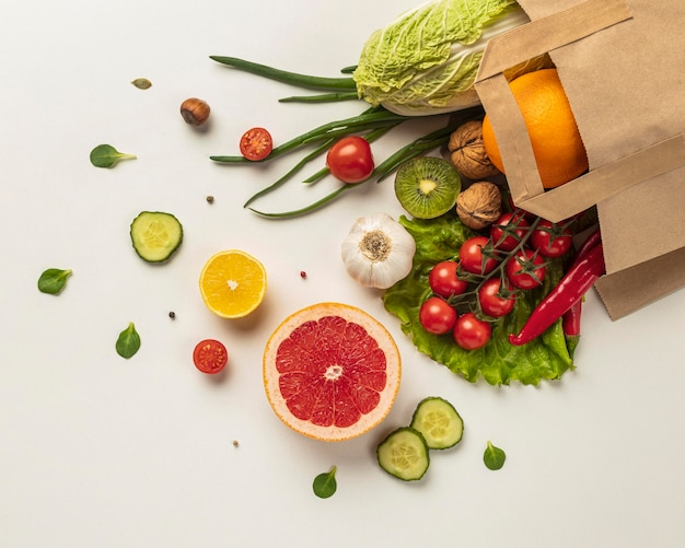 Top view of assortment of vegetables in grocery bag