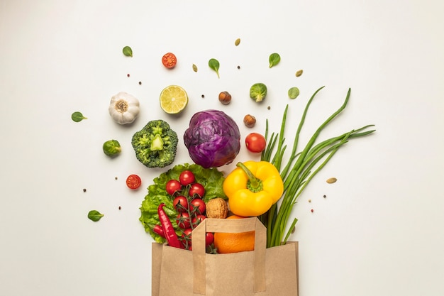 Top view of assortment of vegetables in paper bag