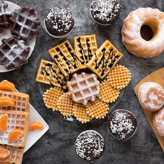 Top view of assortment of waffles and doughnuts
