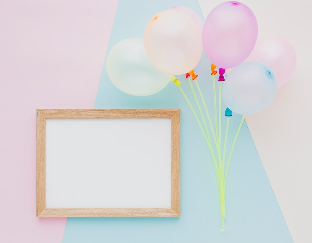Top view assortment with balloons and frame
