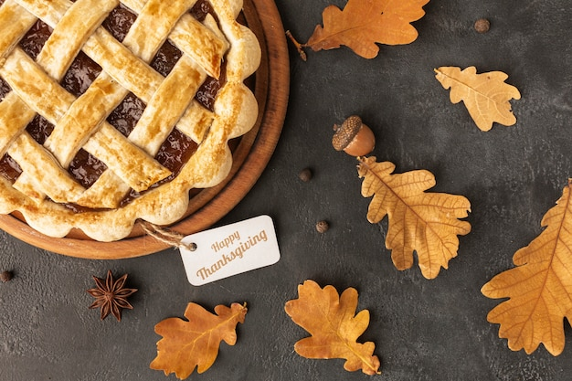 Top view assortment with delicious pie and leaves