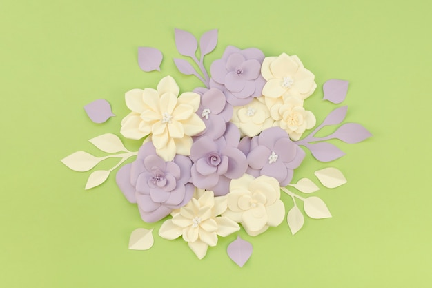 Top view assortment with flowers and green background