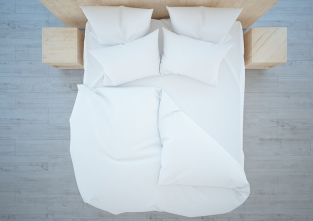 Вид сверху на белые постельные принадлежности подушки и деревянный пол