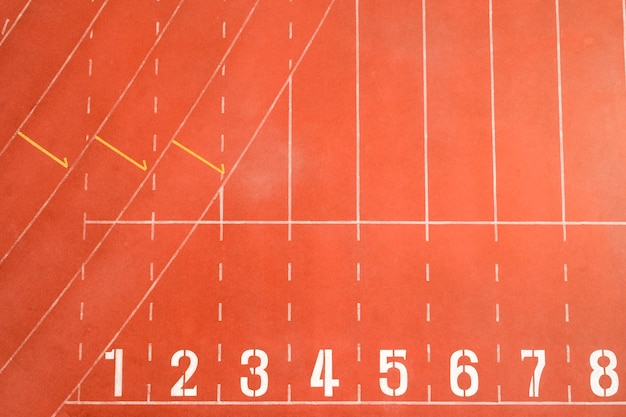 Top view of athletics track start line with lane numbers Premium Photo