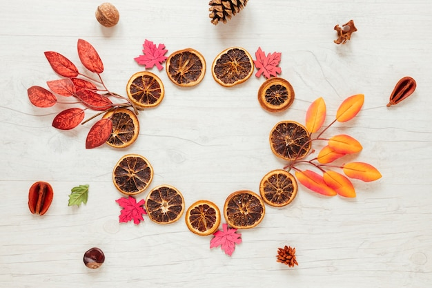 Top view autumn arrangement on wooden background