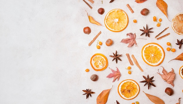 Top view of autumn elements with citrus and copy space