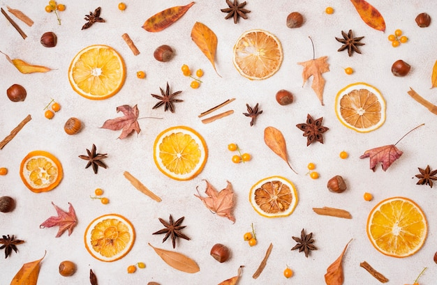 Top view of autumn elements with leaves and citrus