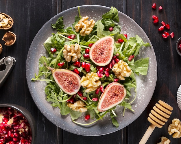 Top view of autumn fig salad on plate with walnuts