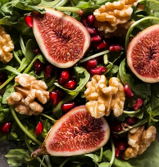 Top view of autumn fig salad and walnuts