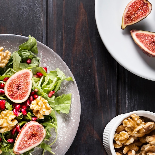 Top view of autumn fig salad with walnuts