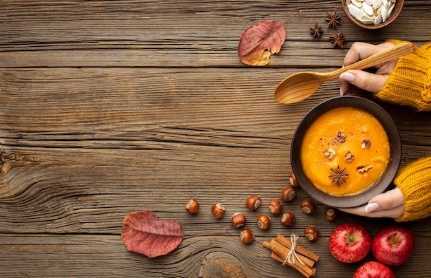 Top view autumn food pumpkin soup copy space