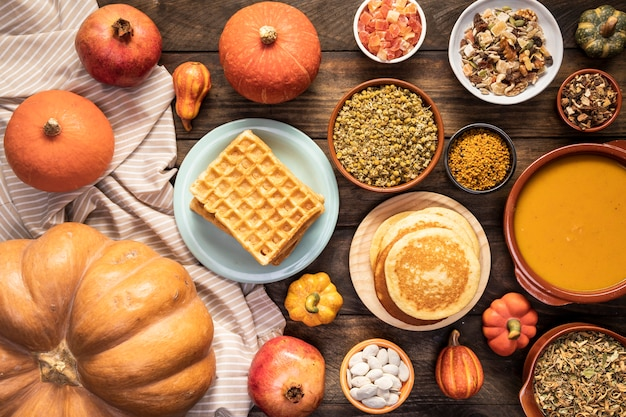 Top view autumn food on sheet and wooden background