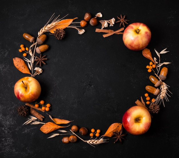 Top view of autumn frame with apples and acorns